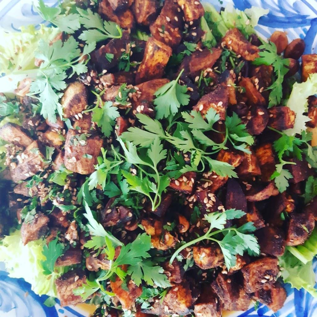 Roasted sweet potato, date and toasted peanuts salad